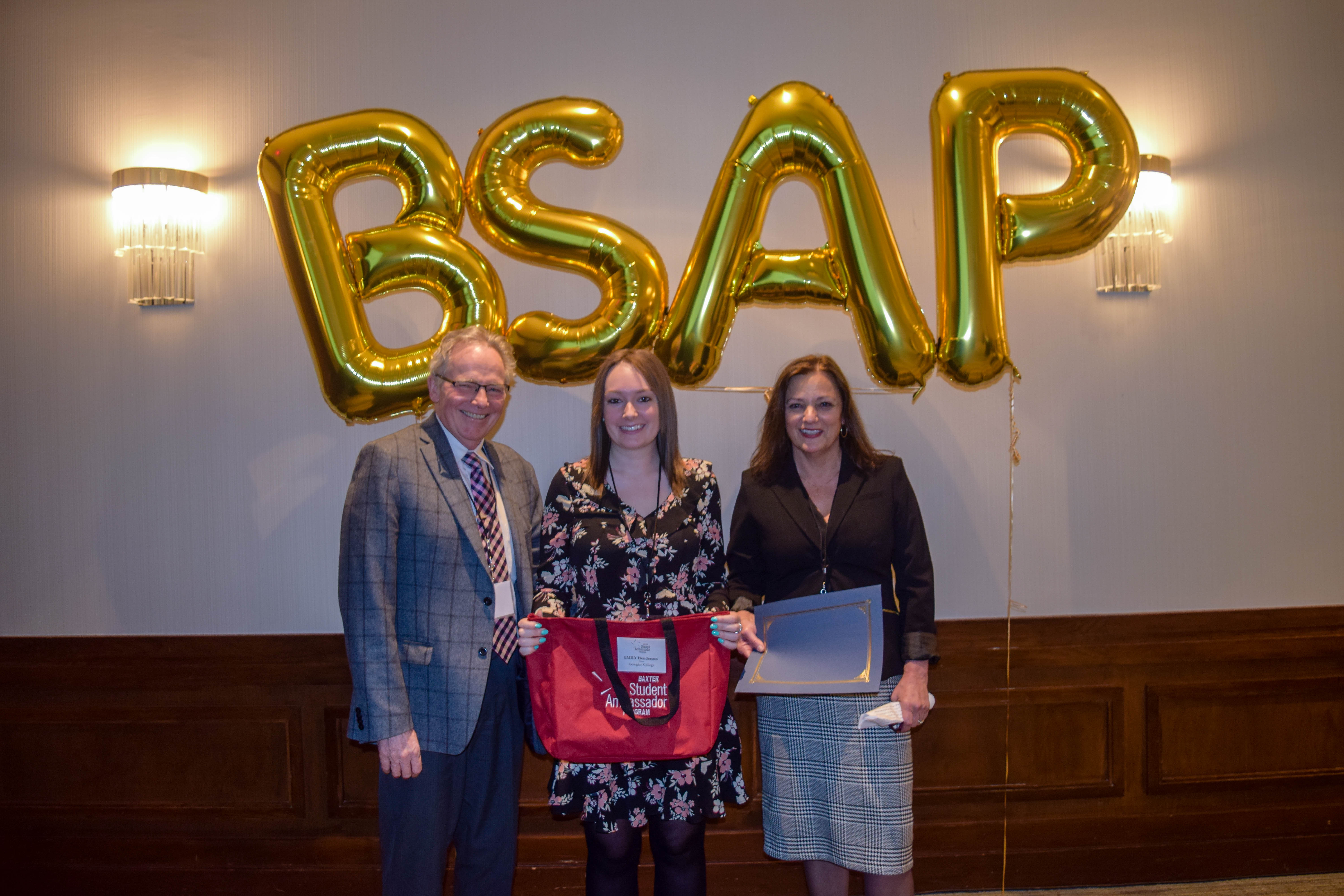 Emily Henderson (Baxter Ambassador, Georgian College) accepts her BSAP certificate and prize bag from David McClung (l) and Wendy McClung (r)